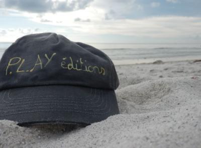 The famous cap P.L.AY signed